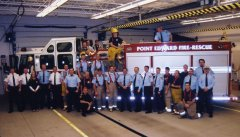 Point Edward Fire Fighters in front of a Fire Truck inside the fire station